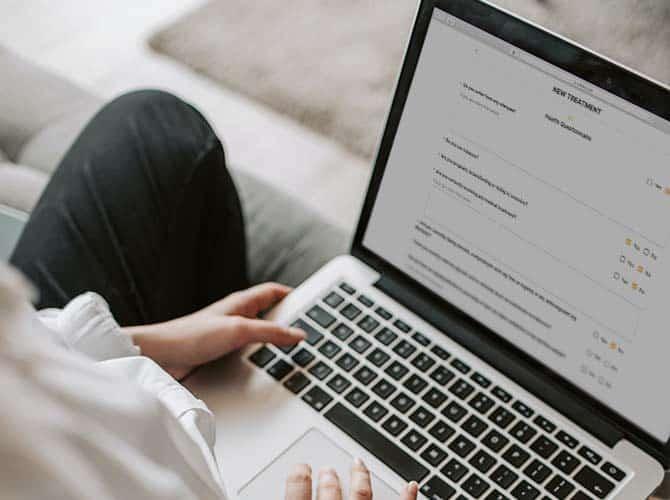 MERIDIQ registration portal health questionnaire on laptop